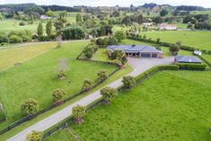 265 M2 HOME WITH 6 CAR GARAGING!